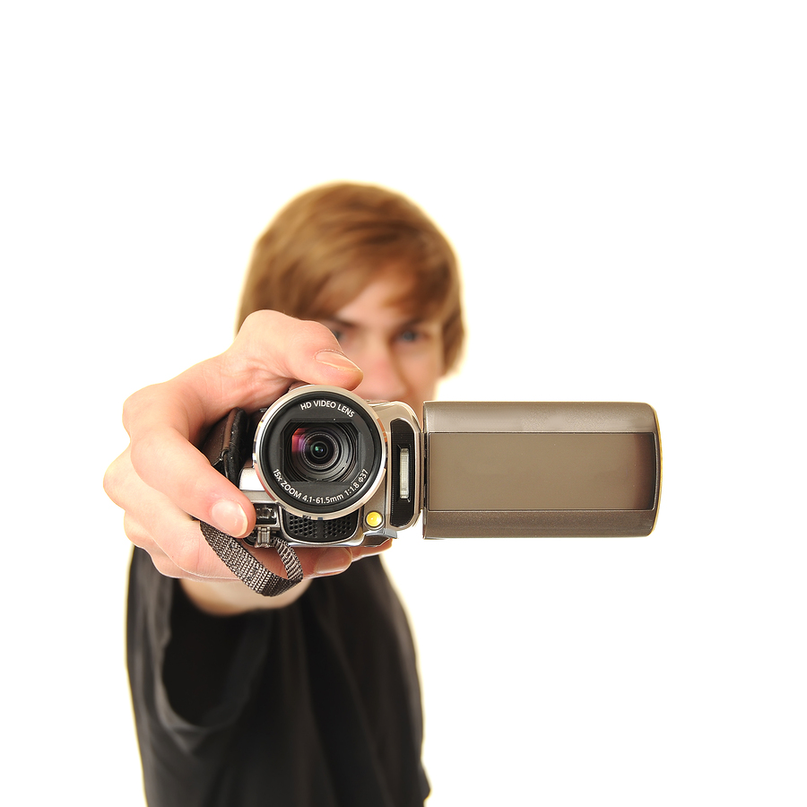 bigstock-Young-Adult-Holding-Camcorder-11597345 Your Digital Marketing Weekly Roundup