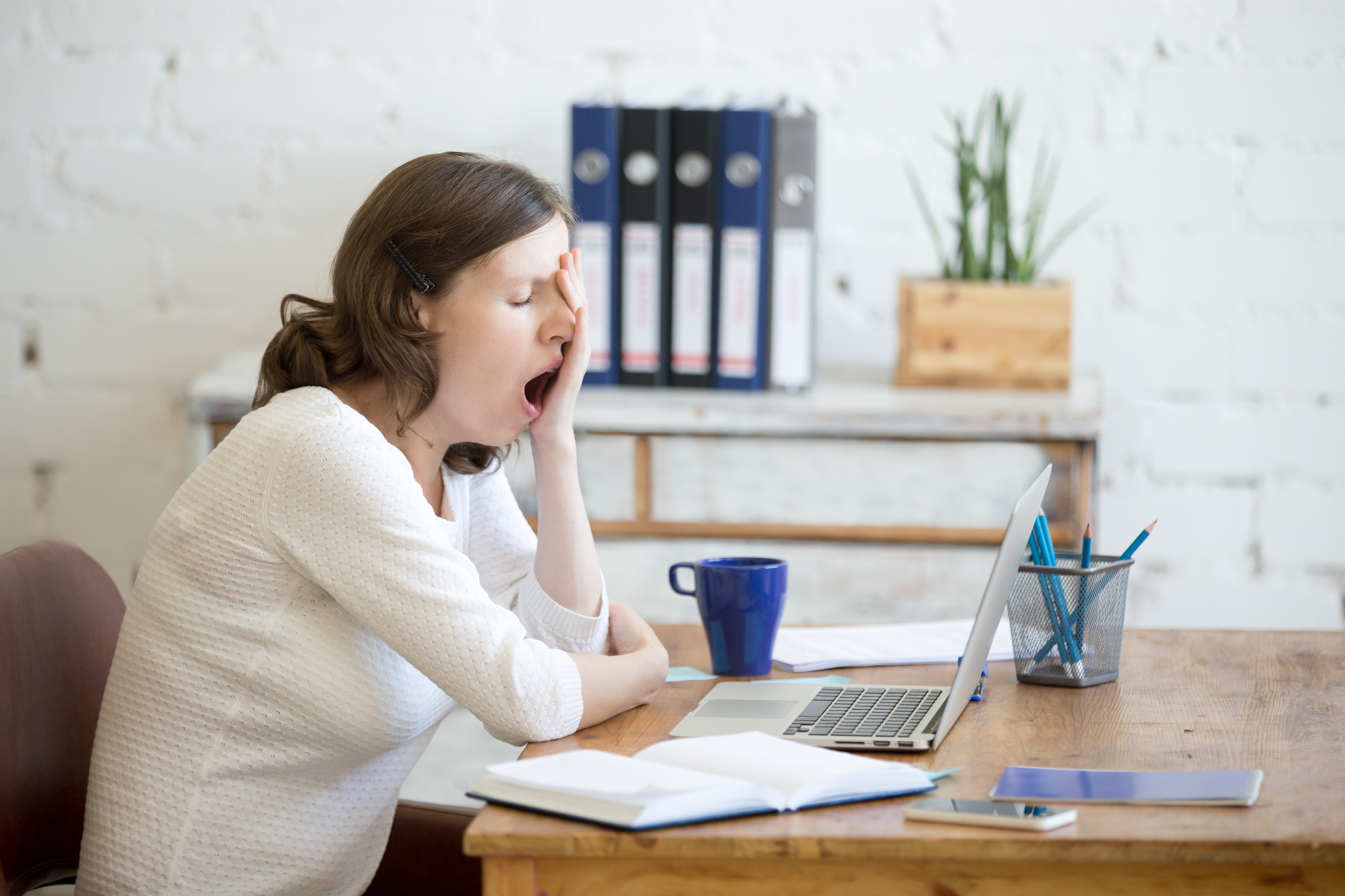bigstock-Sleepy-Young-Worker-Woman-Yawn-143681474 Interesting Content for Boring Industries